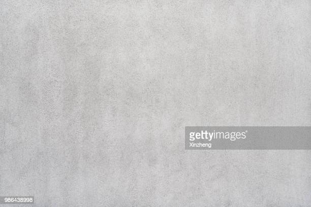 empty studio background, concrete texture - grau stock-fotos und bilder