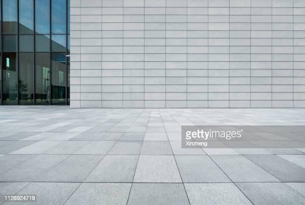empty studio background - stone wall stock-fotos und bilder
