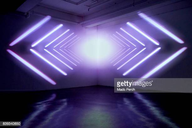 Empty studio space with projected graphic shapes
