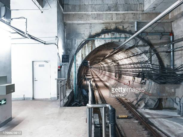 empty subway tunnel - liyao xie stock pictures, royalty-free photos & images