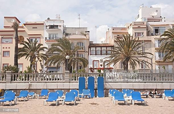 Empty sun loungers await summer in Sitges.