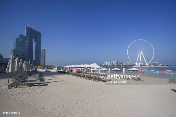 Empty sunbeds are seen at Jumeirah Beach Residence which is usually crowded amid coronavirus fears in Dubai on March 12 2020 Dubai Financial Market...
