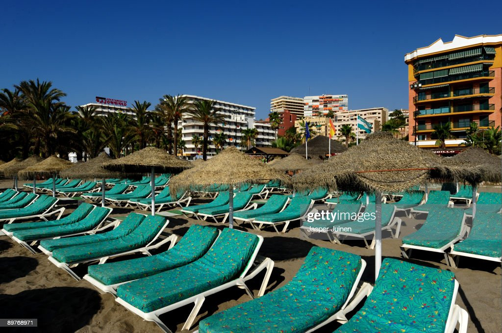 Empty sunbeds wait for tourists at a usually packed Costa del Sol Carihuela beach on August 13, 2009 in Torremolinos, Spain. Altough Spanish resorts remain busy, receiving 23.6 million foreign visitors in the first half year, the economic downturn has seen more than an eleven percent drop in visitors, especially from Britain, over the same period as last year. European holidaymakers are increasingly staying at home for their annual holidays.