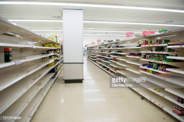 Empty Supermarket pasta shelves are seen in a Sainsbury's Superstore shortly after opening at 6am in London as the British public wake to the news...