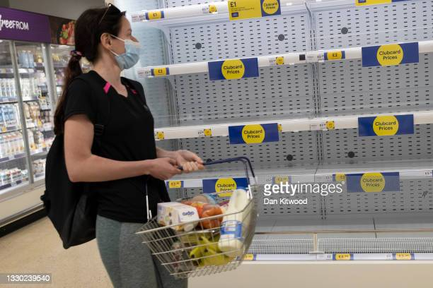 Empty supermarket shelves are seen in a supermarket on July 23, 2021 in London, United Kingdom. There have been reports that some supermarkets across...