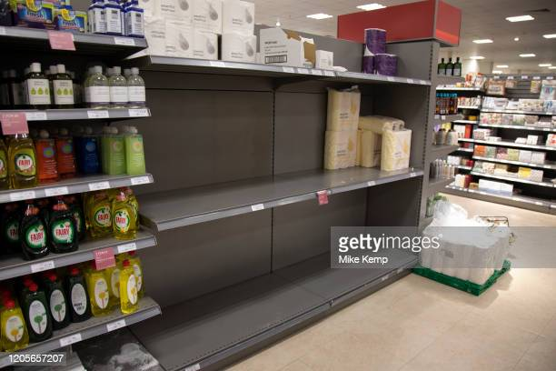 Empty supermarket shelves due to panic buying of essential goods during the coronavirus outbreak on 7th March 2020 in London United Kingdom Some...