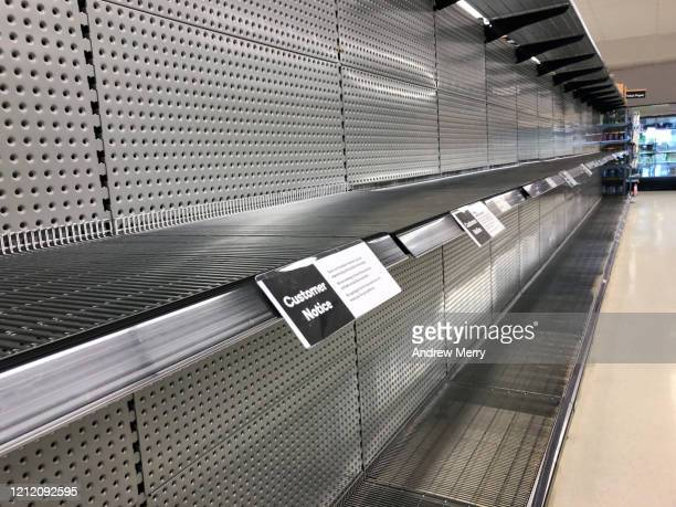 empty supermarket shelves from panic buying during the coronavirus, covid-19 pandemic - panic buying stock pictures, royalty-free photos & images