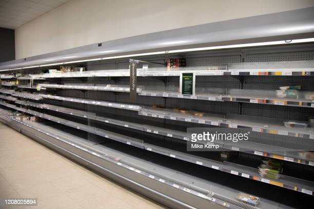 Empty supermarket shelves of what should be full of meat as people continue to stockpile food due to the Covid19 outbreak on 22nd March 2020 in...
