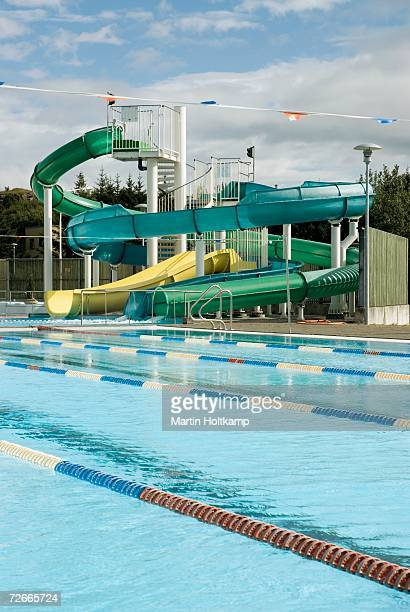 Empty swimming pool and water slides