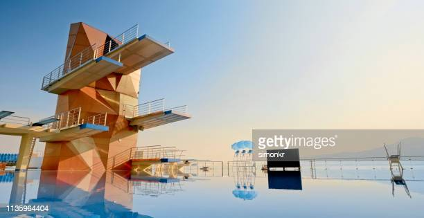empty swimming pool - diving board stock pictures, royalty-free photos & images
