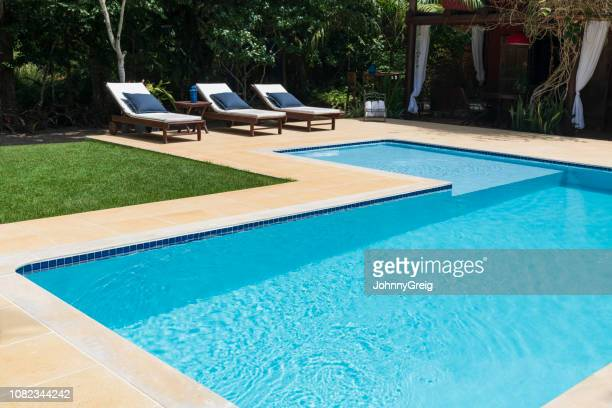 empty swimming pool with lounge chairs - swimming pool stock pictures, royalty-free photos & images