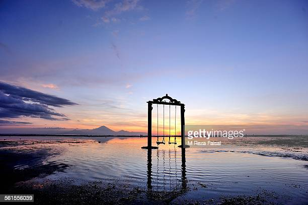 empty swing - gili trawangan stock photos and pictures