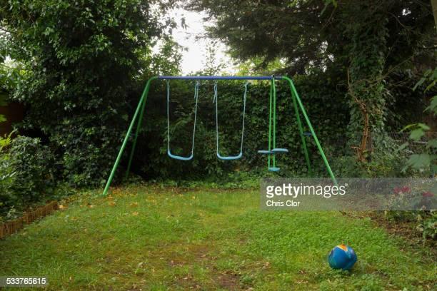 Empty swing set in backyard