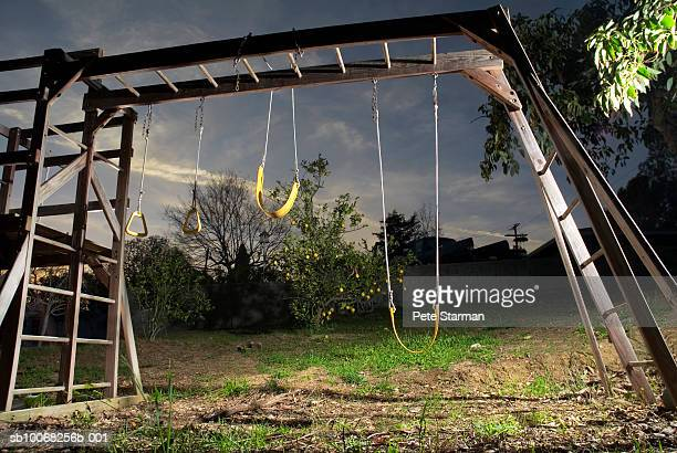empty swings and gymnastic rings - spielgerät stock-fotos und bilder