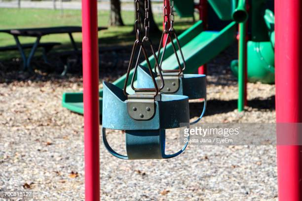 Empty Swings And Slide At Playground