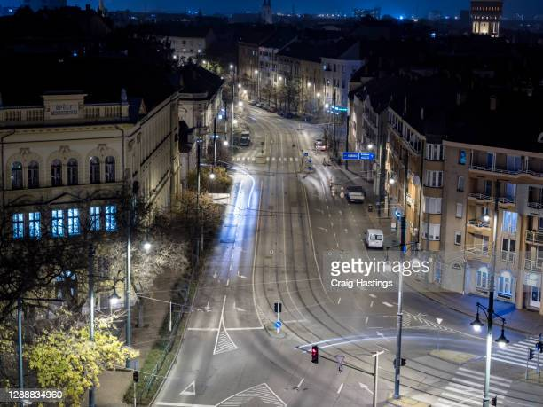 empty szeged shopping and retail street as covid curfew and lockdown measures are implemented - curfew stock pictures, royalty-free photos & images
