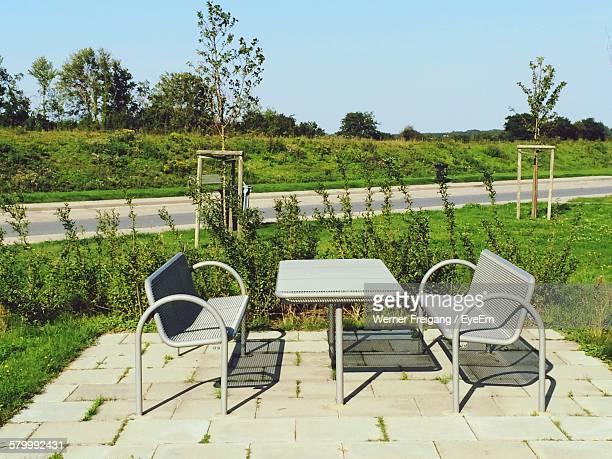 Empty Table And Seats By Plants