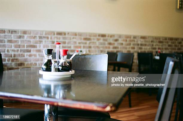 empty table at vietnamese restaurant - soy sauce stock photos and pictures