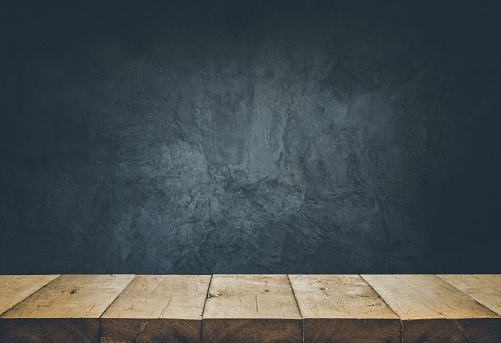 Empty table top with cement wall background. 917339656