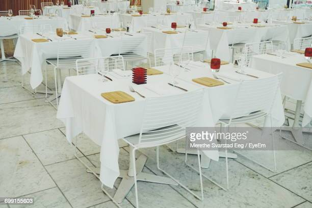 Empty Tables And Chairs At Restaurant