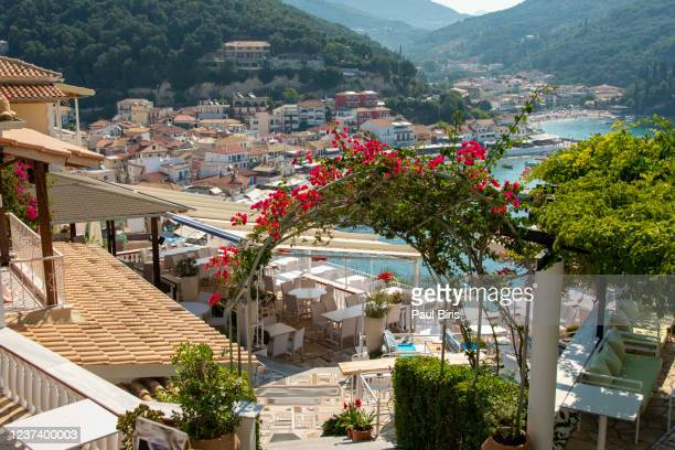 empty tables and chairs in a greek taverna in parga, epirus, greece - epirus greece stock pictures, royalty-free photos & images