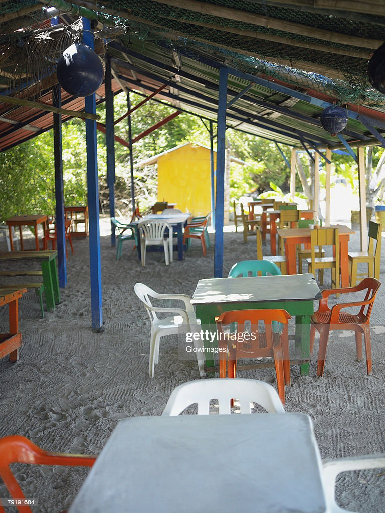 Empty tables and chairs in a restaurant, Providencia, Providencia y Santa Catalina, San Andres y Providencia Department, Colombia : Foto de stock