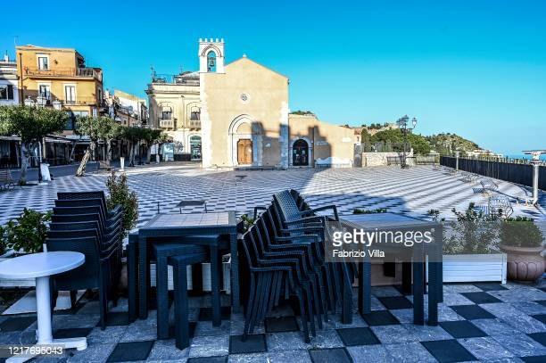 Empty tables at a closed restaurant at the city center after government restrictions to avoid spread of Covid19 on April 08 2020 in Taormina Italy...