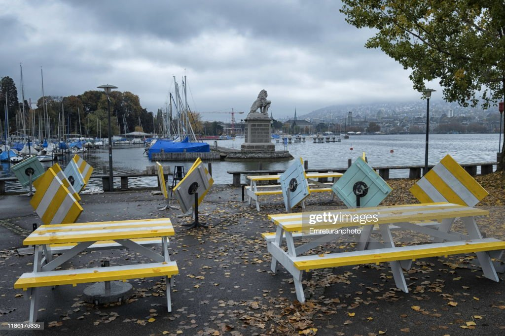Empty tables of a restaurant and lake view on a rainy day,Zurich. : Stock Photo
