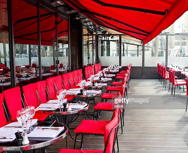 empty tables on restaurant terrace in Paris