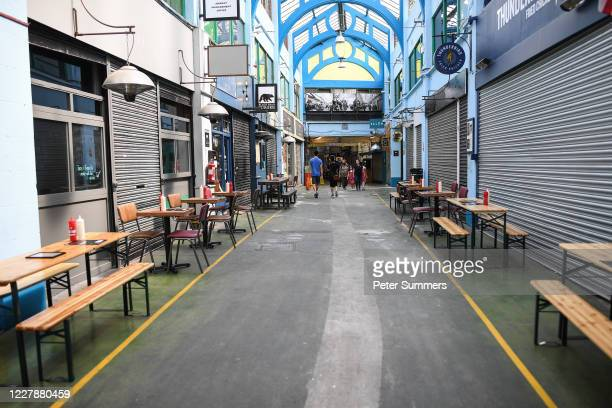 Empty tables outside closed cafes in Brixton Village on August 2, 2020 in London, England. British Prime Minister Boris Johnson has said it is time...
