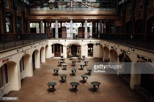 Empty tables stand in a courtyard of a deserted Covent Garden covered market in London, England, on May 28, 2020. The UK is now in its tenth week of...