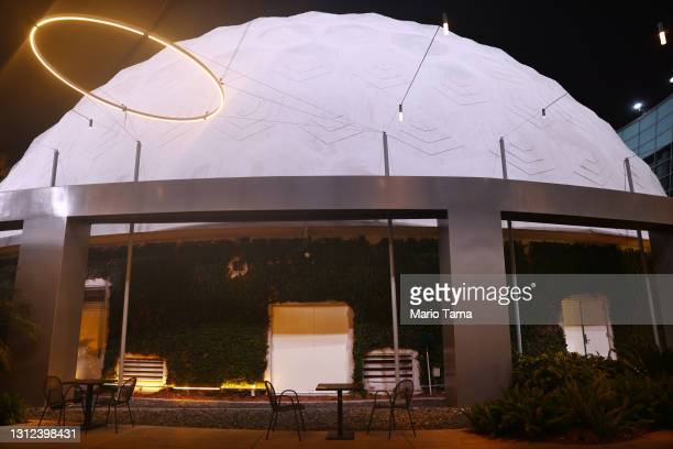 Empty tables stand outside the famed Cinerama Dome at the shuttered ArcLight Hollywood movie theater on April 13, 2021 in Los Angeles, California....