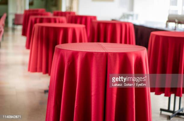 empty tables with red clothes in restaurant - テーブルクロス ストックフォトと画像