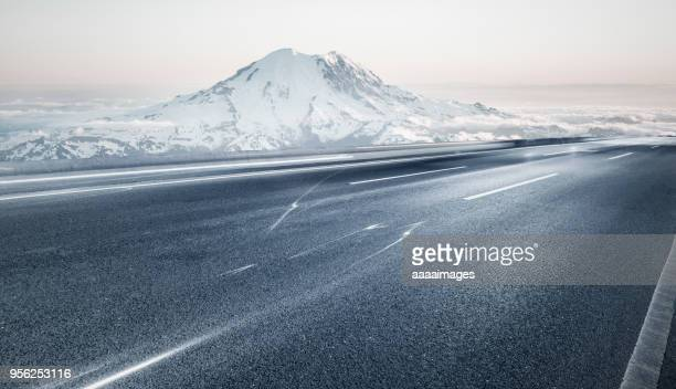 empty tarmac road with mt rainier on background - mountain road stock pictures, royalty-free photos & images