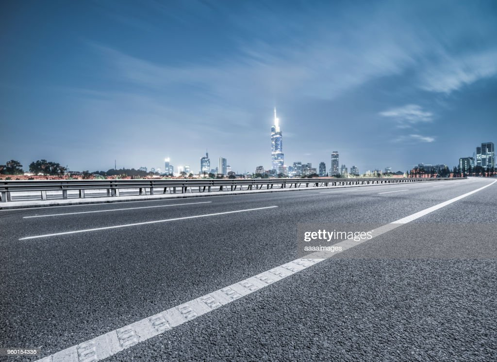 empty tarmac road with nanjing panoramic skyline on background : Stock-Foto