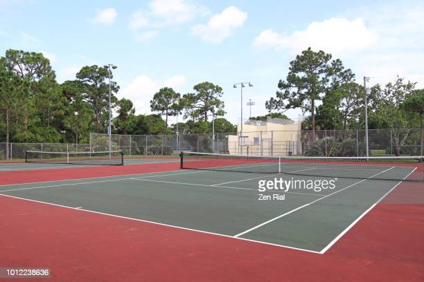 empty tennis court and racquetball courts in a tropical setting - tennis stock-fotos und bilder