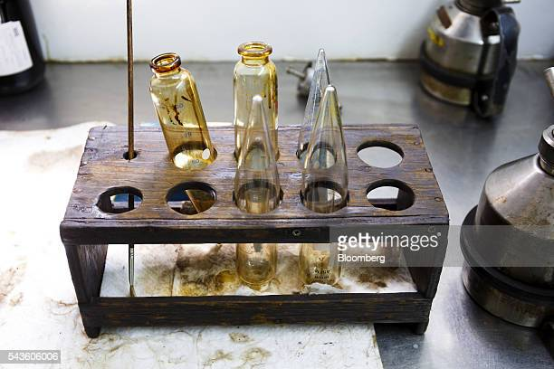 Empty test tubes sit in the laboratory following oil sample tests on the Casablanca oil platform operated by Repsol SA in the Mediterranean Sea off...