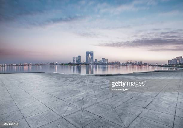 empty town square with suzhou skyline on background - suzhou stock pictures, royalty-free photos & images