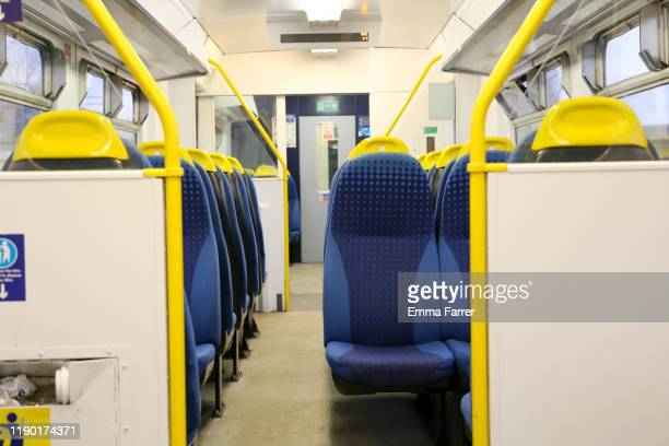 empty train carriage - vehicle seat stock pictures, royalty-free photos & images