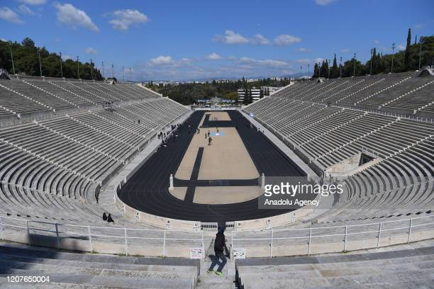 Empty tribunes are seen during the olympic flame handover ceremony for the 2020 Tokyo Summer Olympics in Athens, Greece on March 19, 2020. The...
