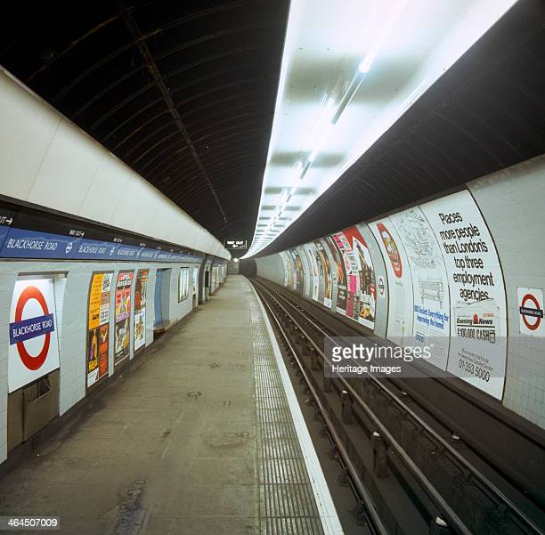 Empty tube station Blackhorse Road on the Victoria Line London 1974 Period posters on the wall include adverts for Marlboro Cigarettes and the...