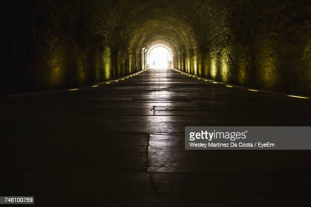 empty tunnel at panathinaiko stadium - light at the end of the tunnel stock pictures, royalty-free photos & images