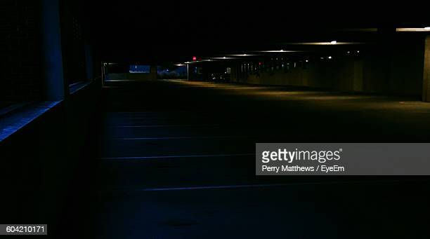 empty underground parking lot - empty lot night stock pictures, royalty-free photos & images