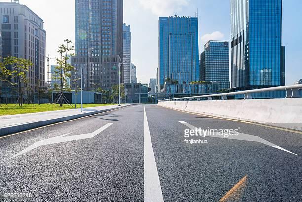 empty urban road through modern city
