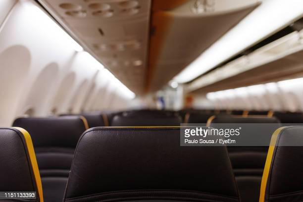 empty vehicle seats in airplane - seat stock pictures, royalty-free photos & images
