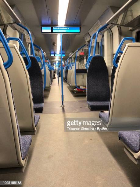 empty vehicle seats in train - train interior stock pictures, royalty-free photos & images