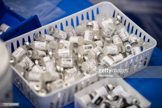 Empty vials of saline solution used with Pfizer-BioNTech Covid-19 vaccine at the Atlantic County vaccination megasite in Atlantic City, New Jersey,...