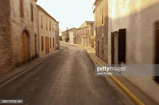 empty village street - saint ferme stock photos and pictures