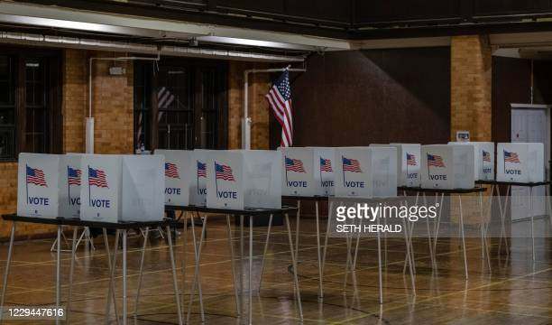 Empty voting booths are seen in Flint, Michigan at the Berston Fieldhouse polling place on November 3, 2020. - The US is voting Tuesday in an...