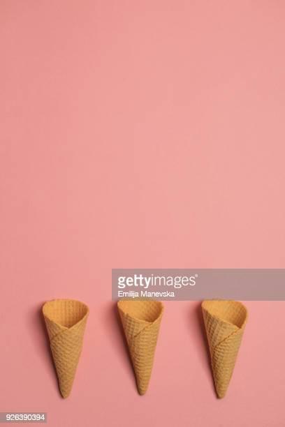 empty waffle ice cream cones - kegel stockfoto's en -beelden
